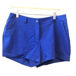 Bright blue shirt, shorts with belt loops